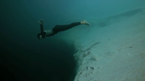 http://www.diving-industry.com/2010/06/10/diver-base-jumps-largest-underwater-sinkhole/